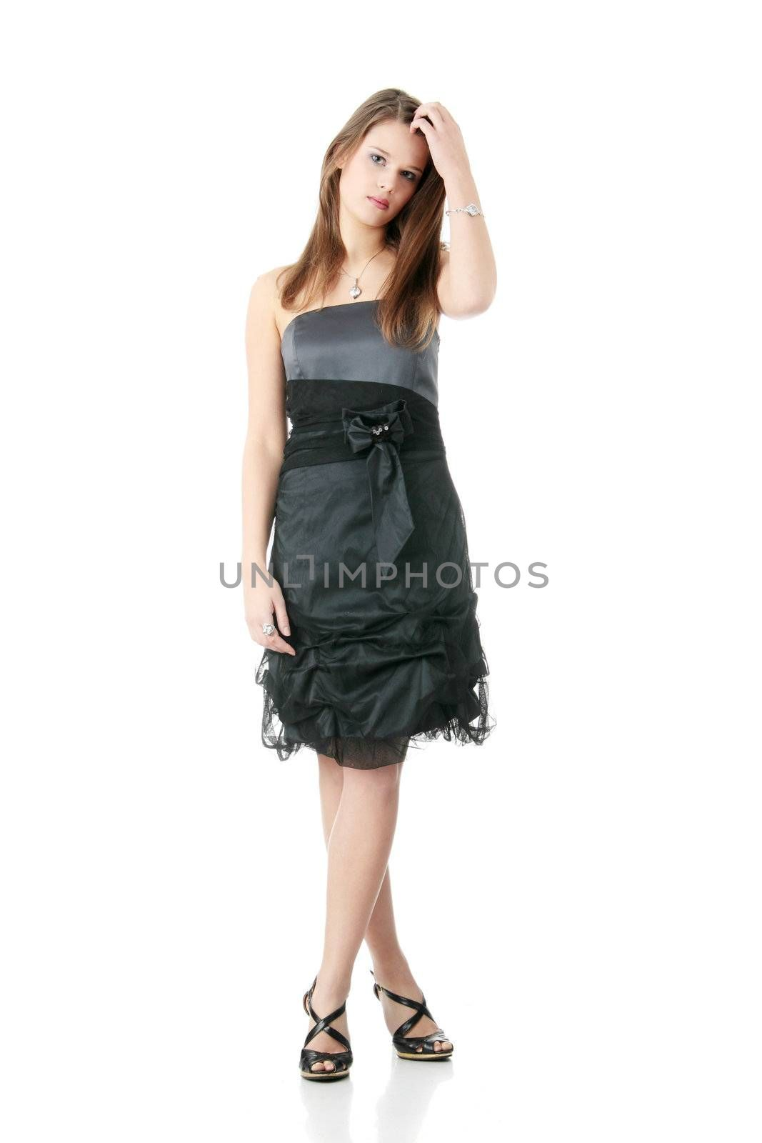 Young elegant woman in black dress, isolated on white