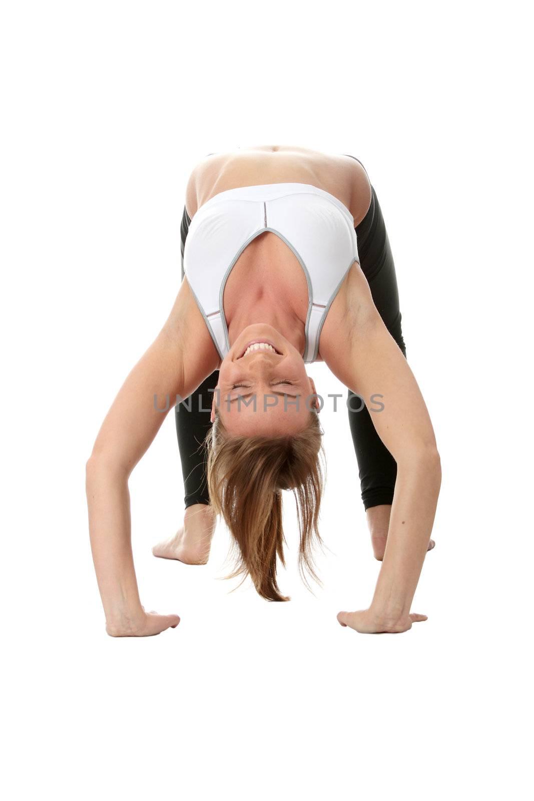 Young caucasian woman exercising yoga