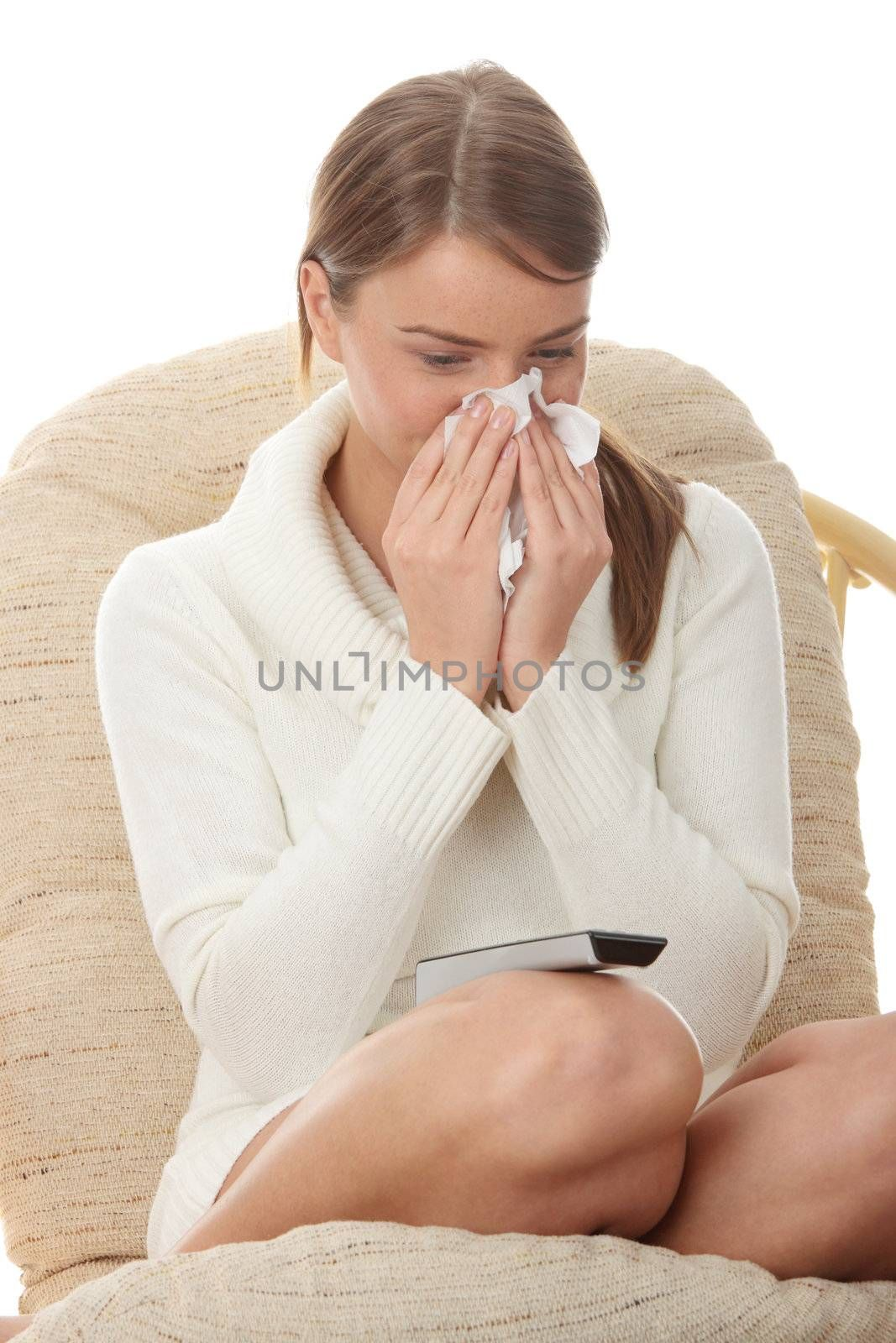 Young blond woman with remote control watching tv and crying