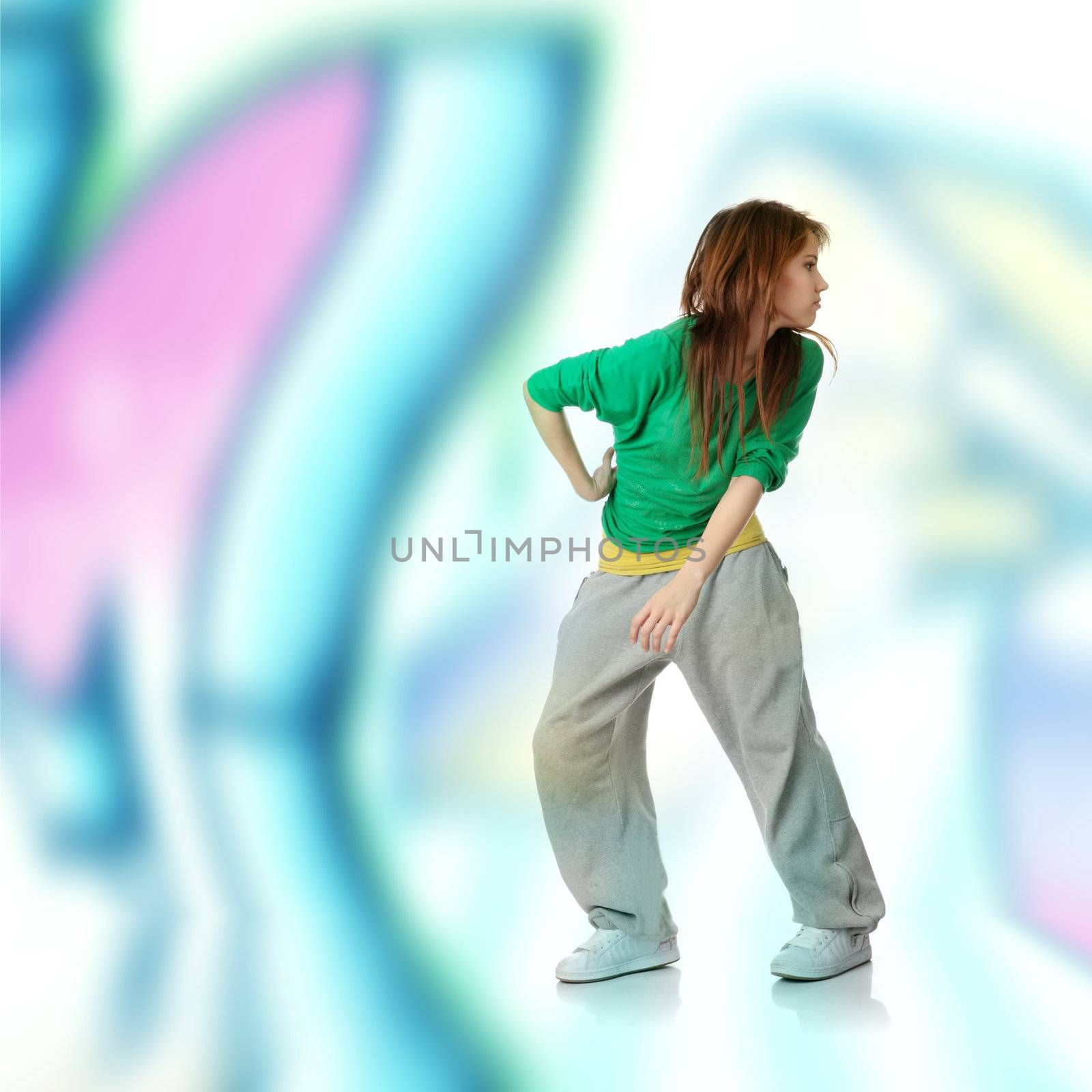 Modern dancer,  against abstract grafitti background