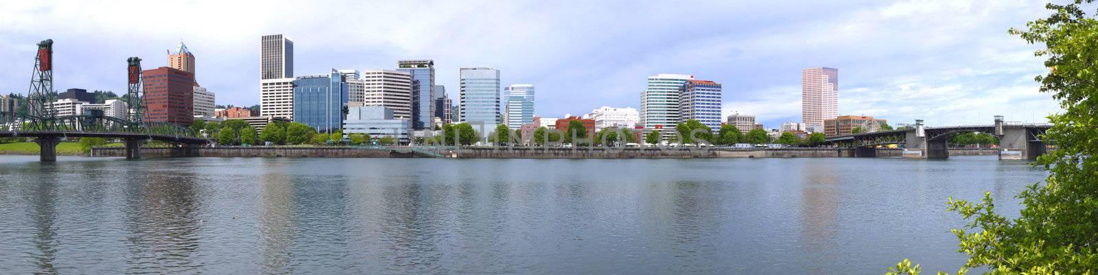 A panorama of Portland Oregon w/the Hawthorne bridge & the Burnside bridge at each ends.