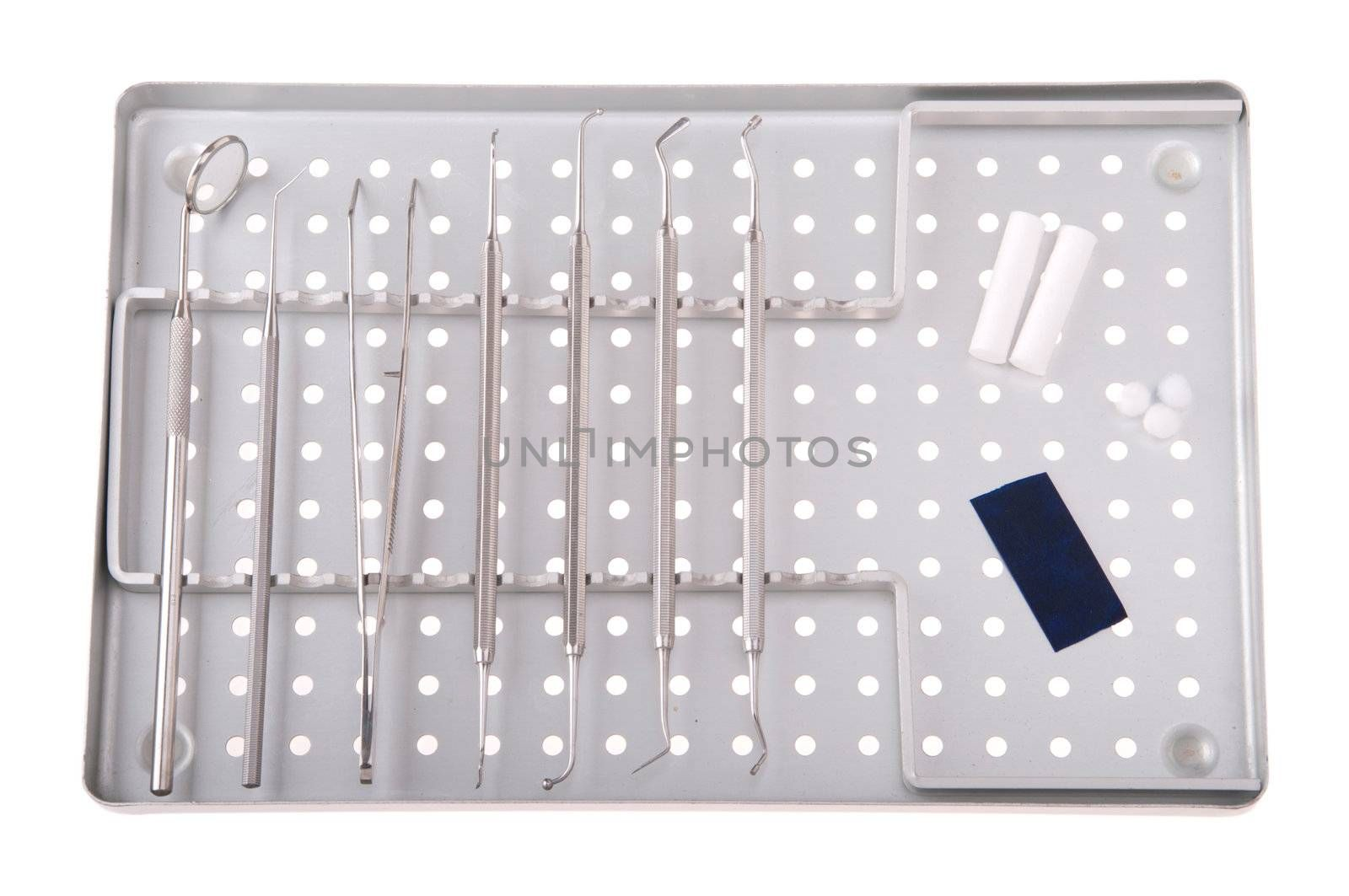 dentistry kit in a metal tray (surgery instruments, articulation paper, cotton rolls and wools)