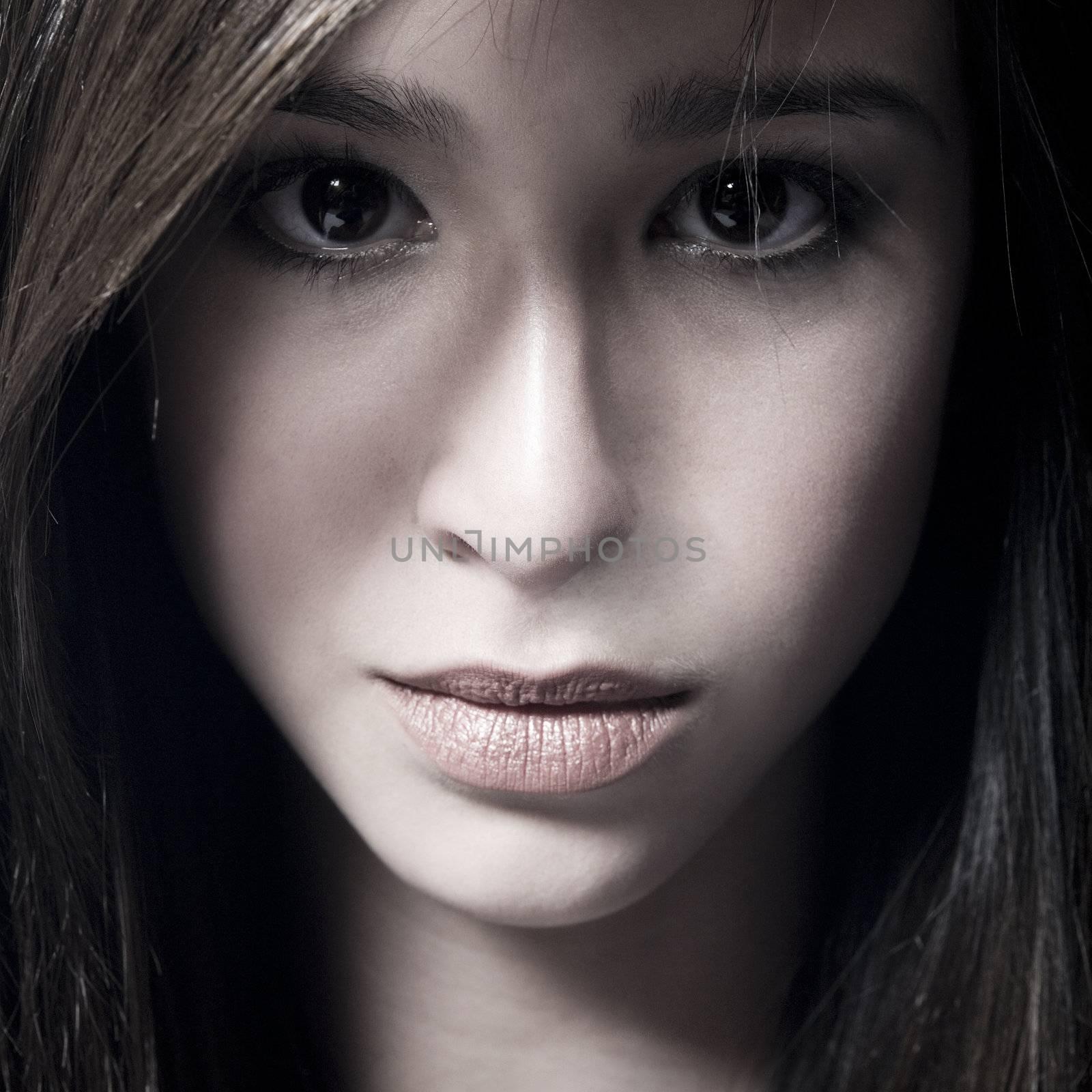 Studio portrait of a beautiful mixed race, vietnamese girl