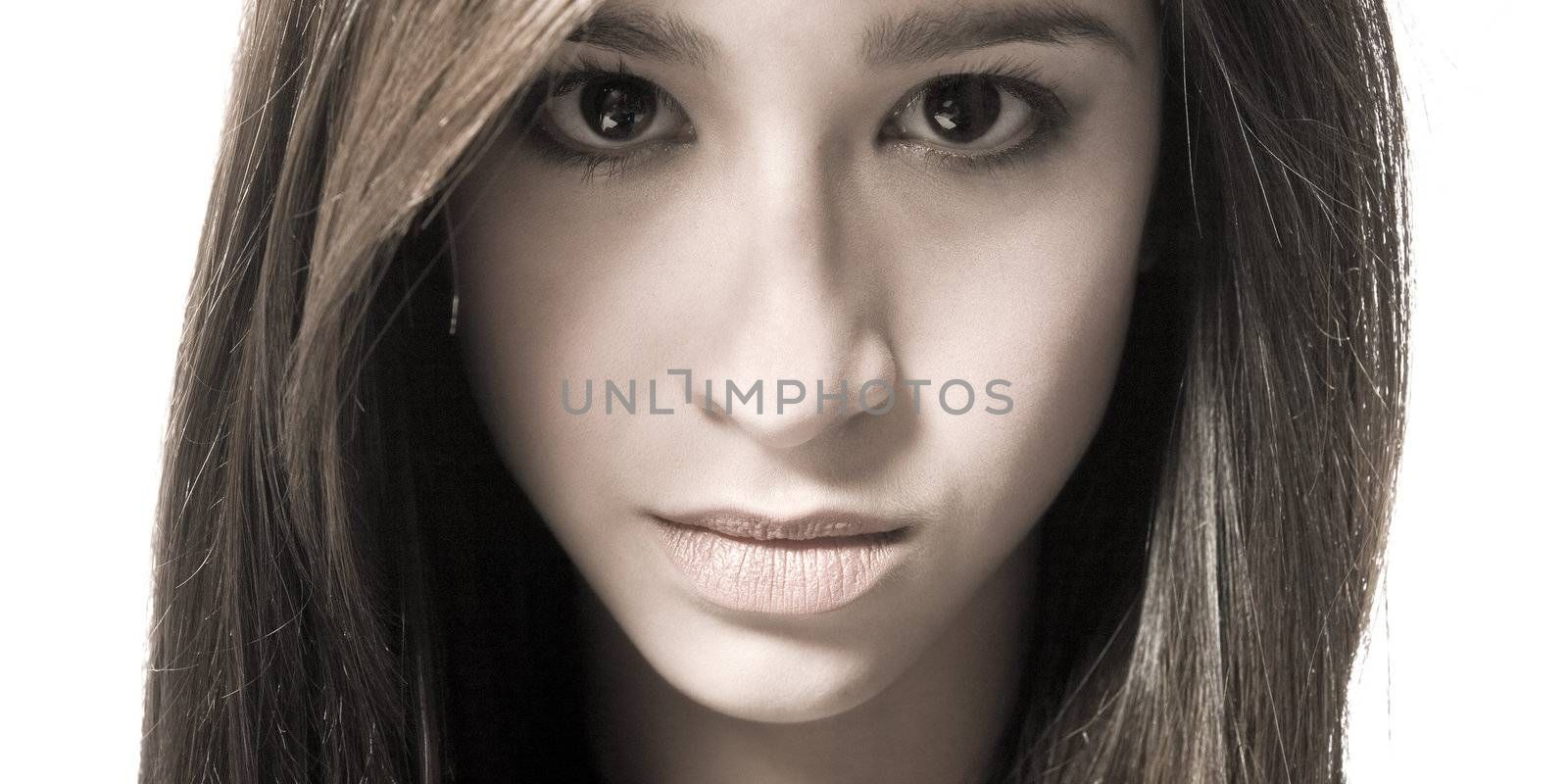 Studio portrait of a beautiful mixed race, vietnamese girl with hypnotic eyes