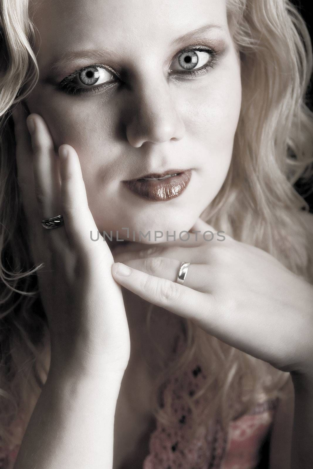 Studio portrait of a blond young lady feeling beautiful