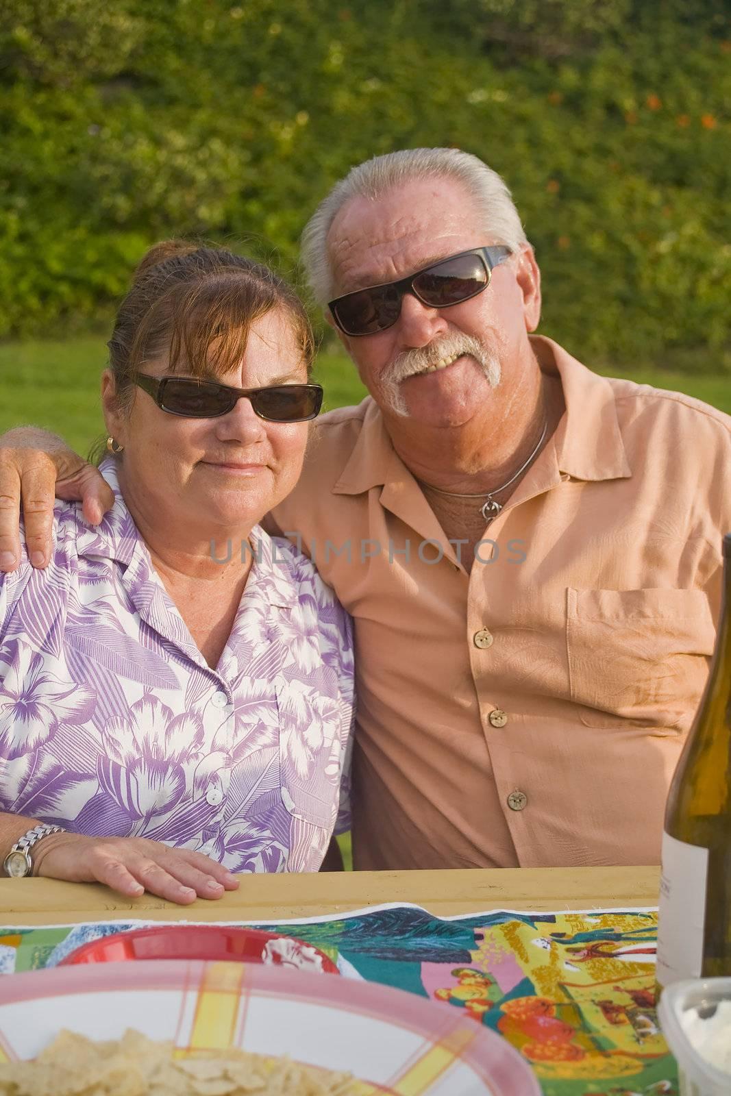 Senior Couple enjoys a Picnic outdoors Vertical Orientation