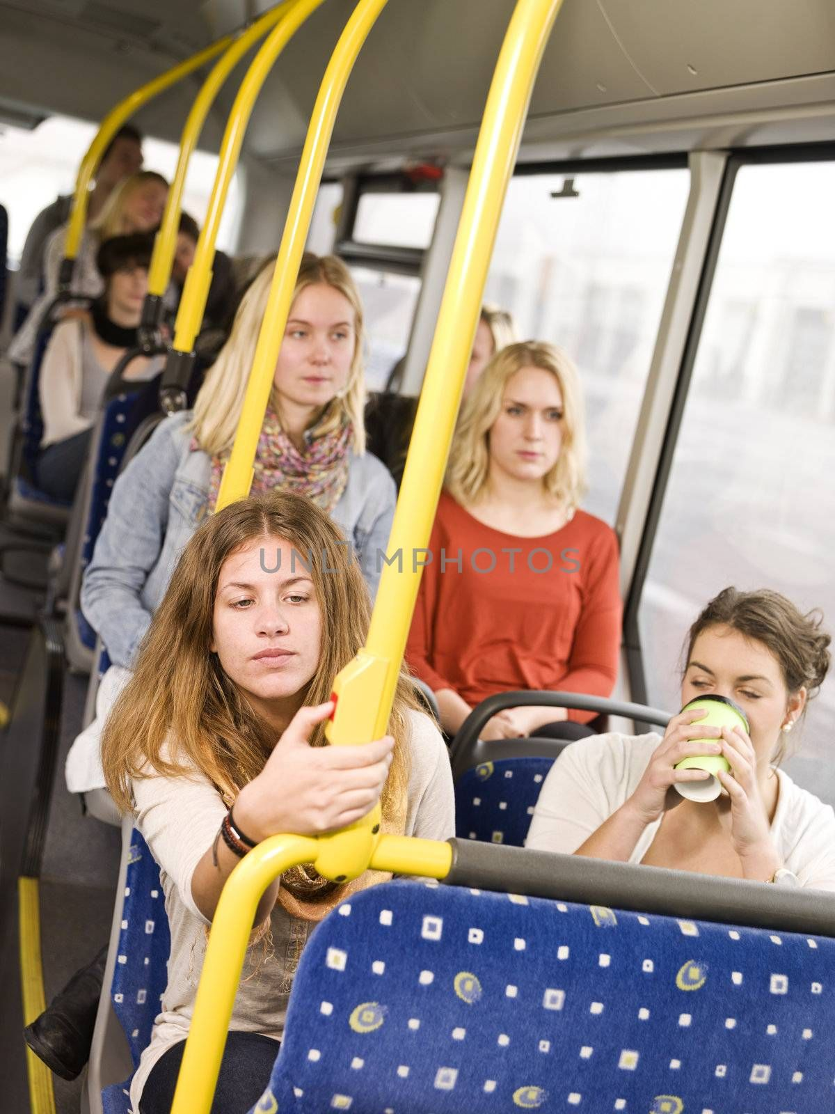 Woman pressing the stop botton on the bus