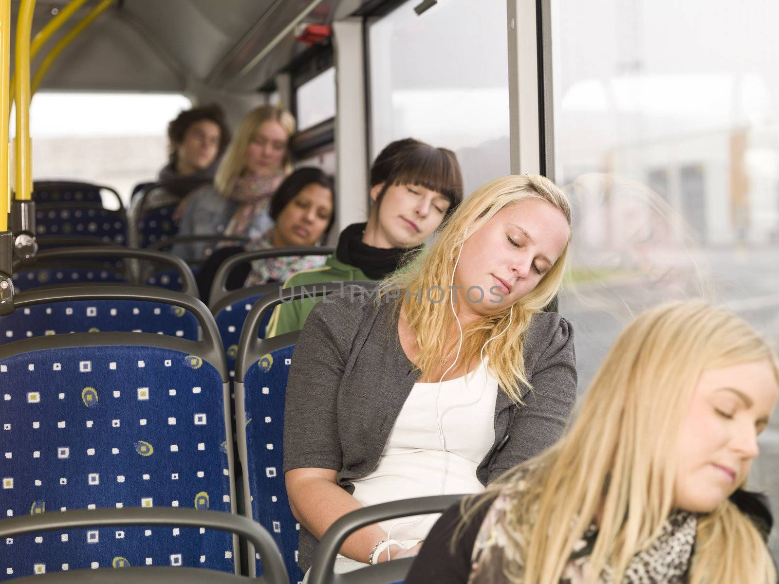 Small group of people sleeping on the bus