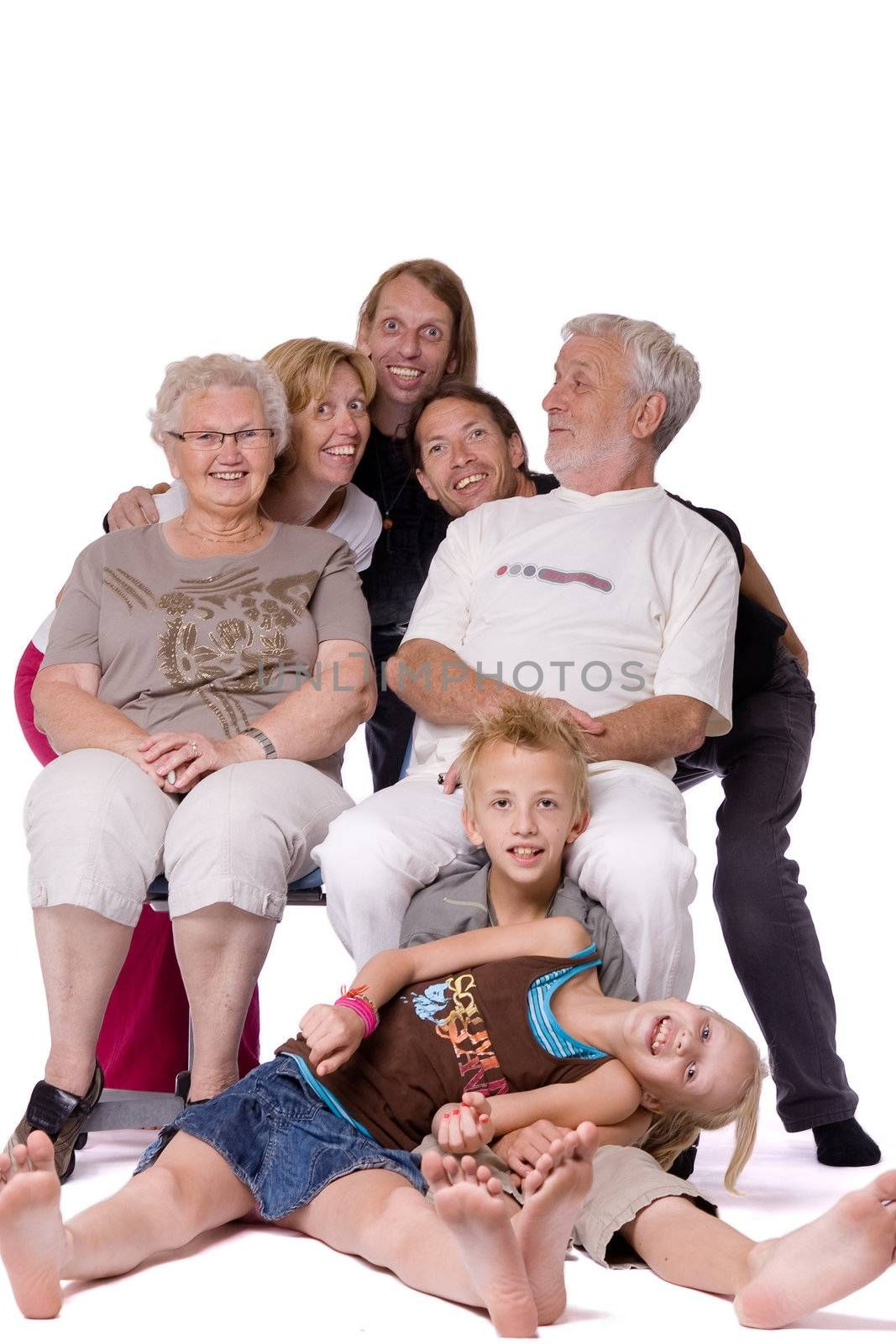 Studio family portrait where the whole family is acting crazy