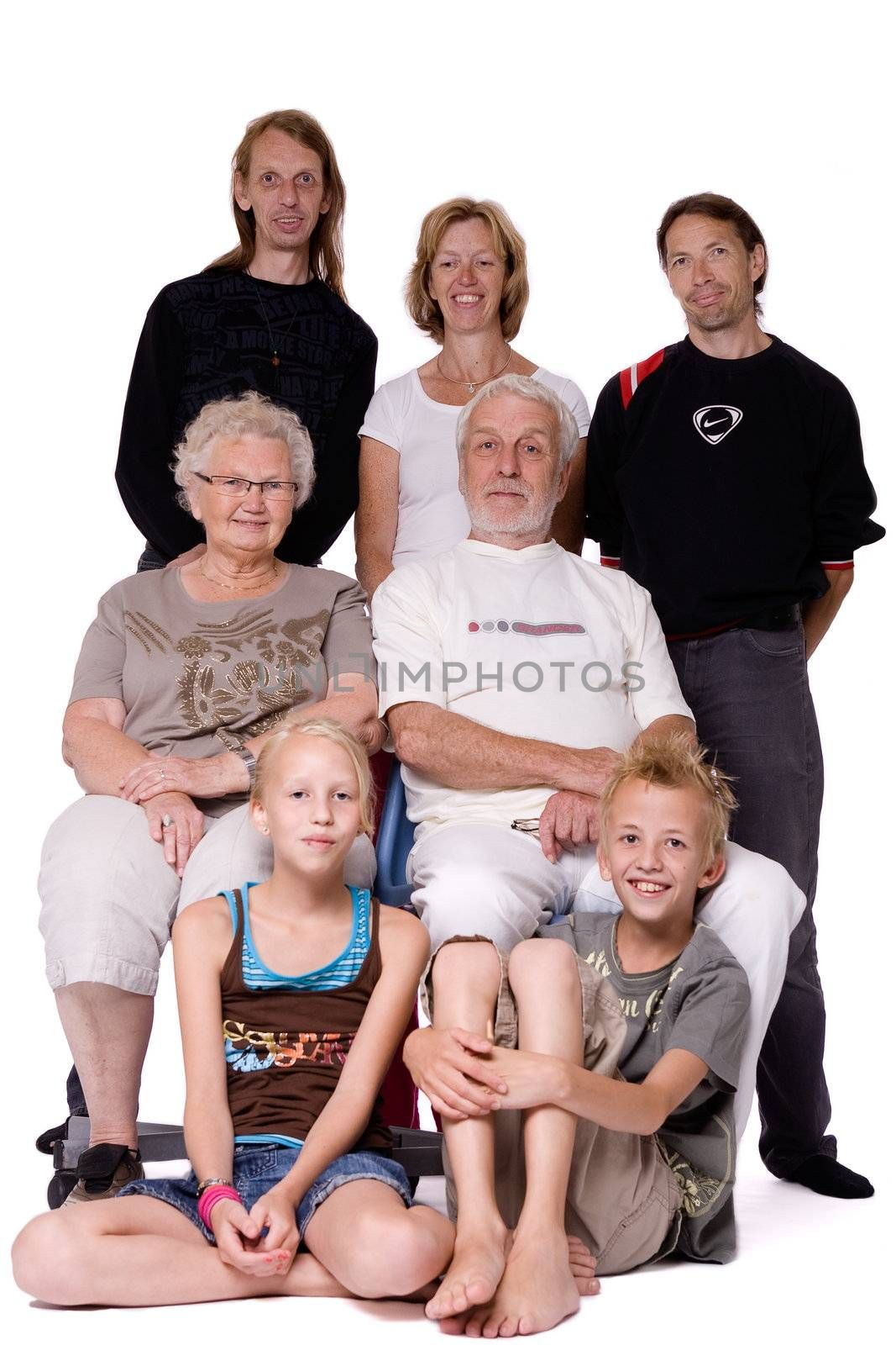 Studio family portrait of a family trying to be serious