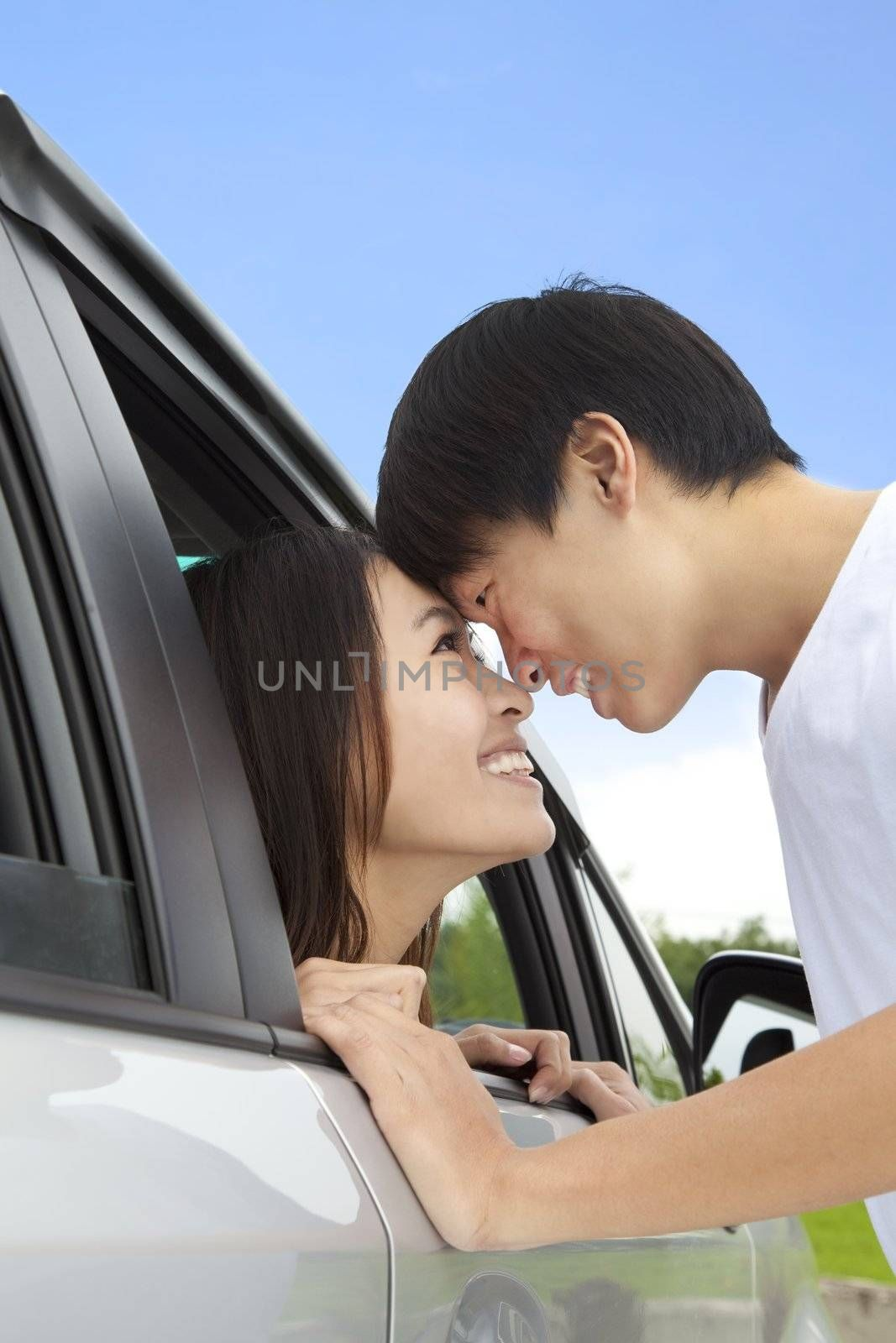 romantic couple looking at each other in the car
