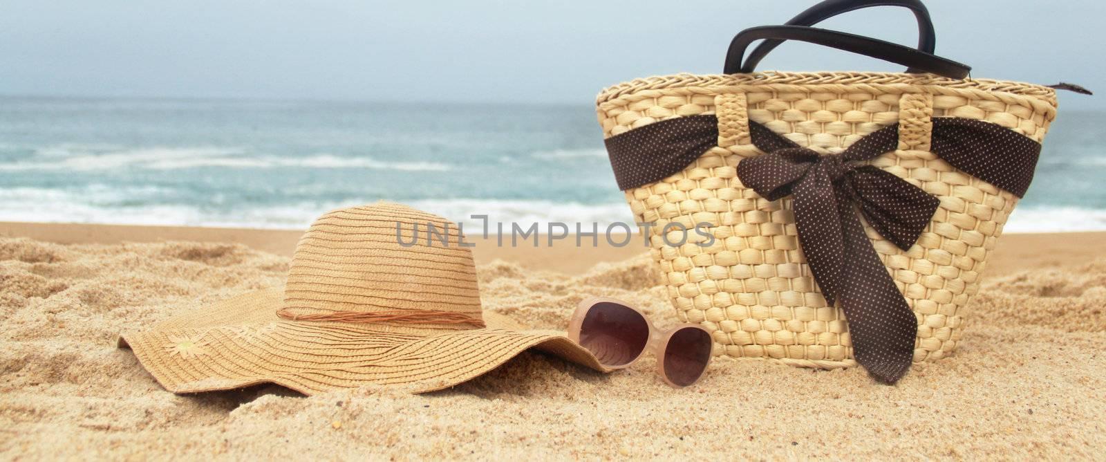 Sea time - seacoast, straw beach bag and sunglasses