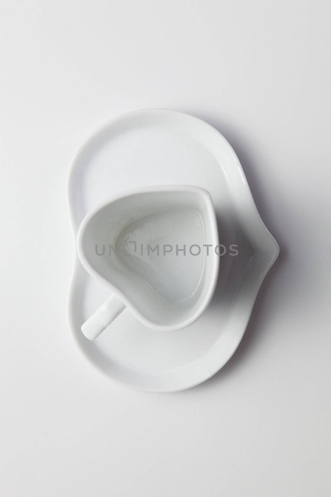 heart shape of coffee cup on the plain background