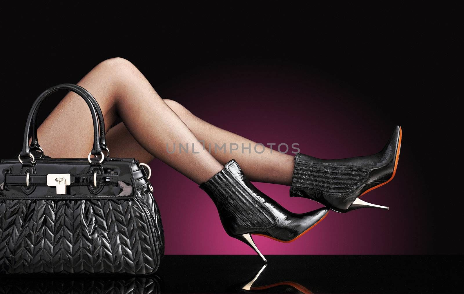 sexy woman with trendy black bag, only legs