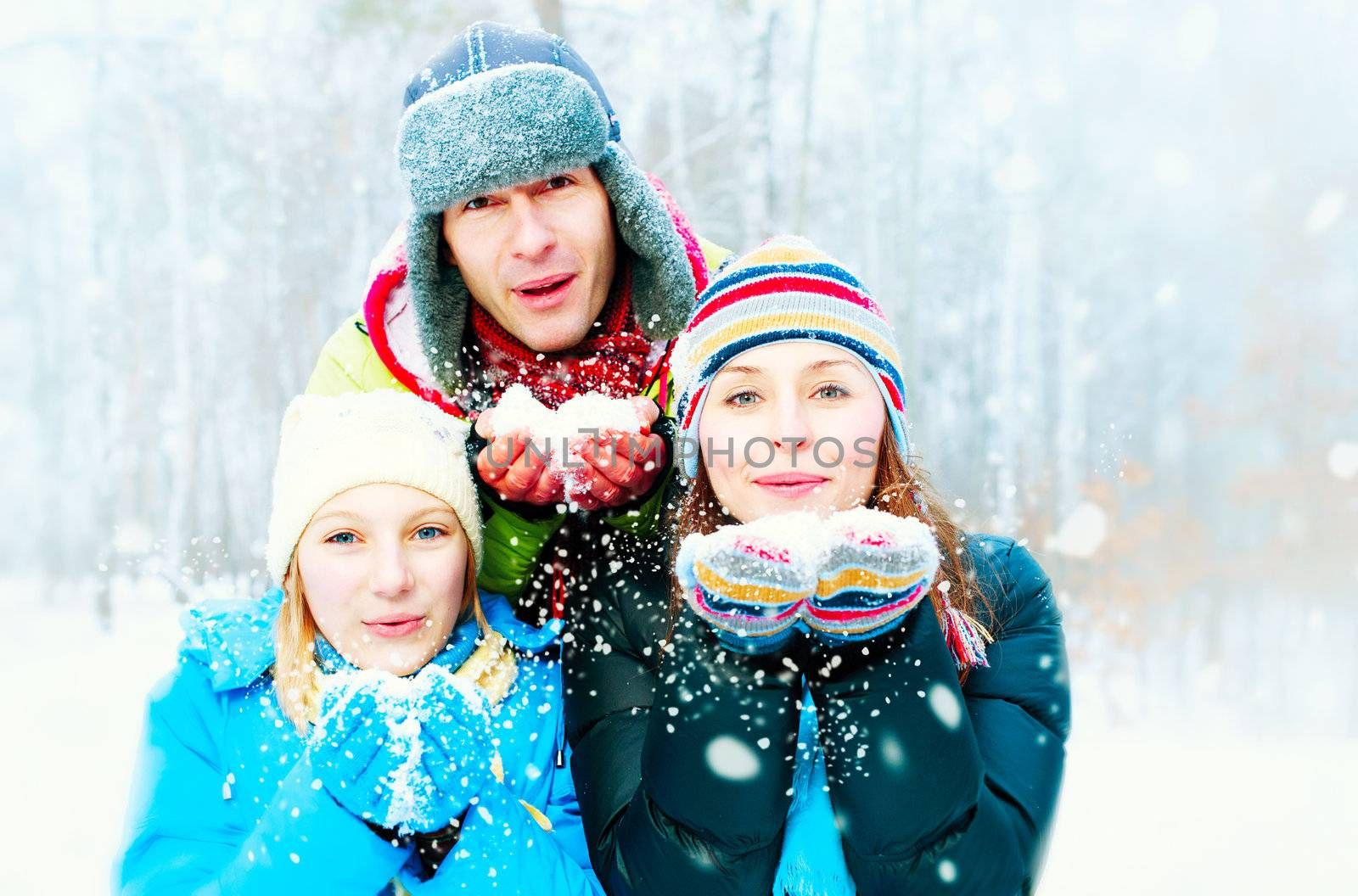 Family Outdoors. Happy Family Blowing Snow