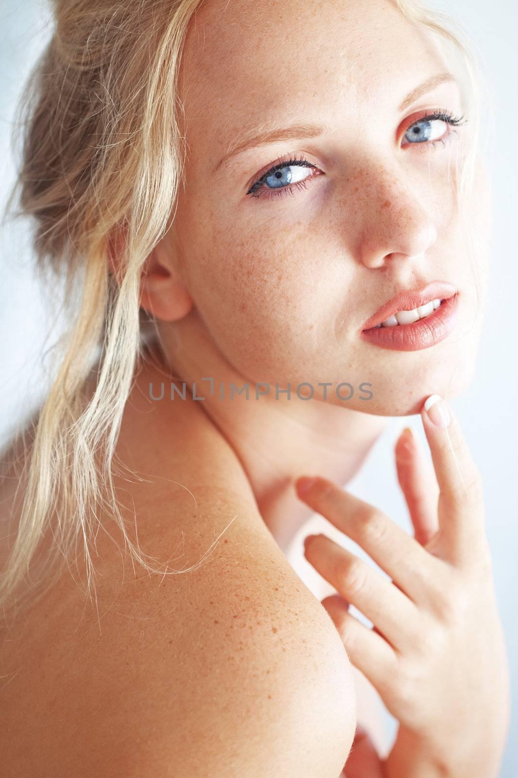 Sensual portrait of beautiful young blond woman