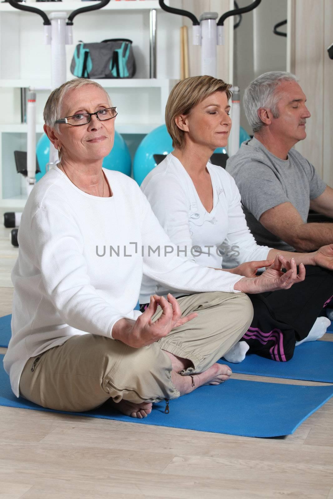 Seniors practicing yoga