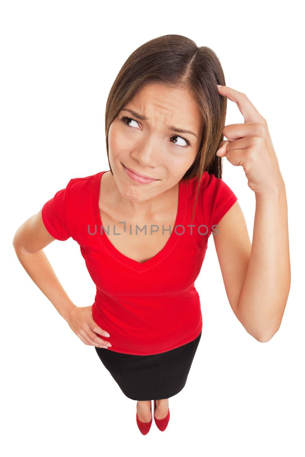Contused thinking woman. Funny high angle studio portrait of a bewildered and confused woman scratching her head as she seeks a solution isolated on white background. Multiethnic female model.