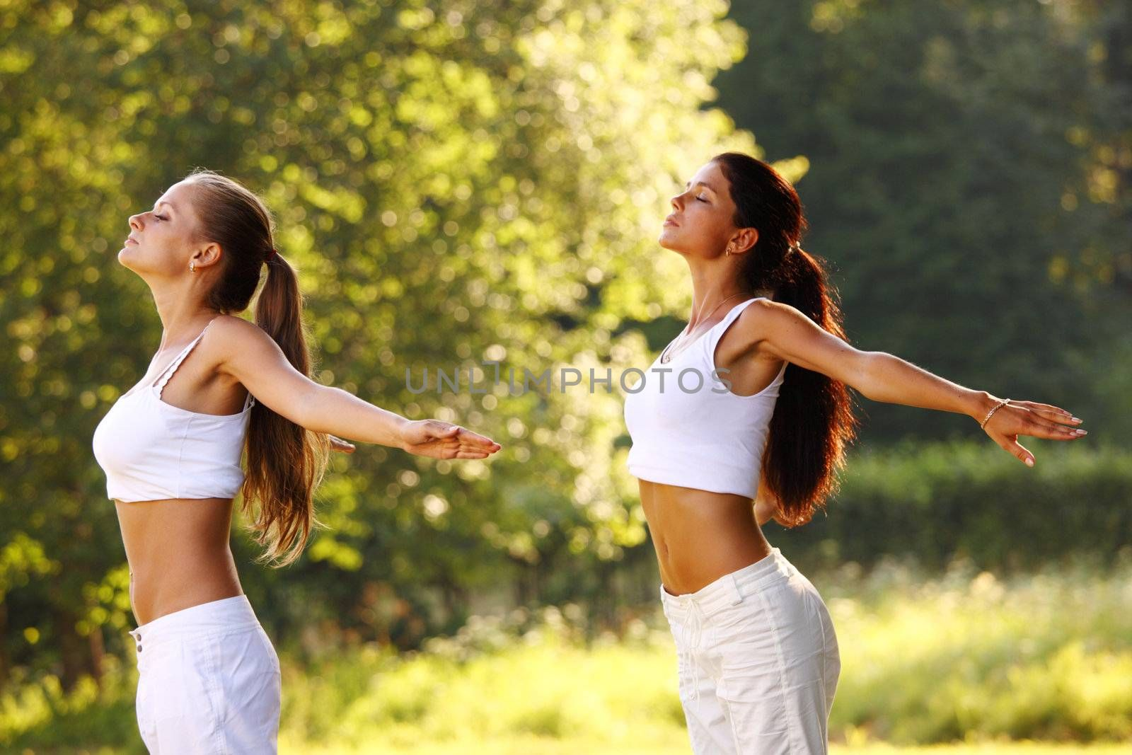 yoga woman on green park background