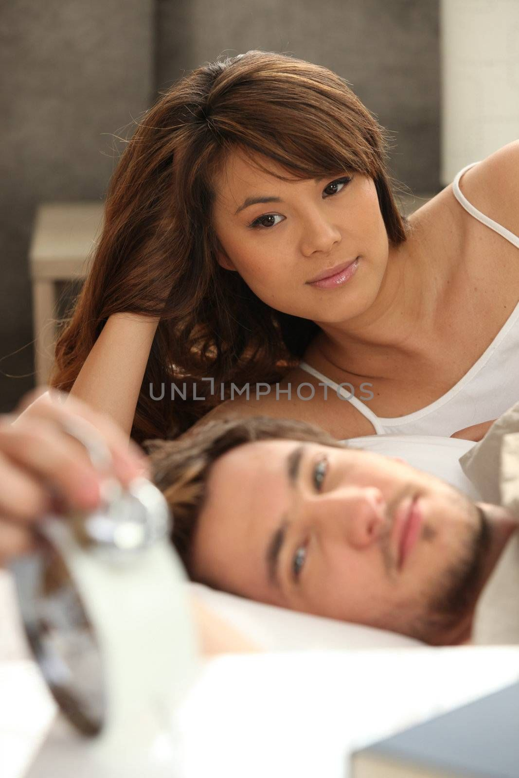 asian beauty with boyfriend in bed