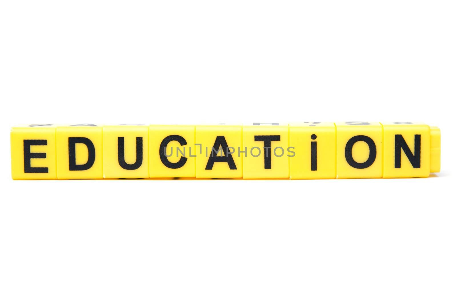 An image of yellow blocks with word ''education''on them