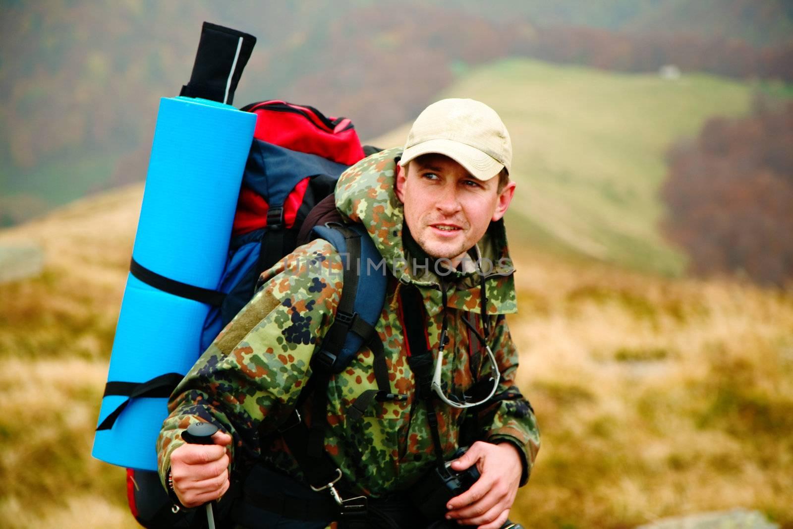 A man walking in mountains. Travel theme