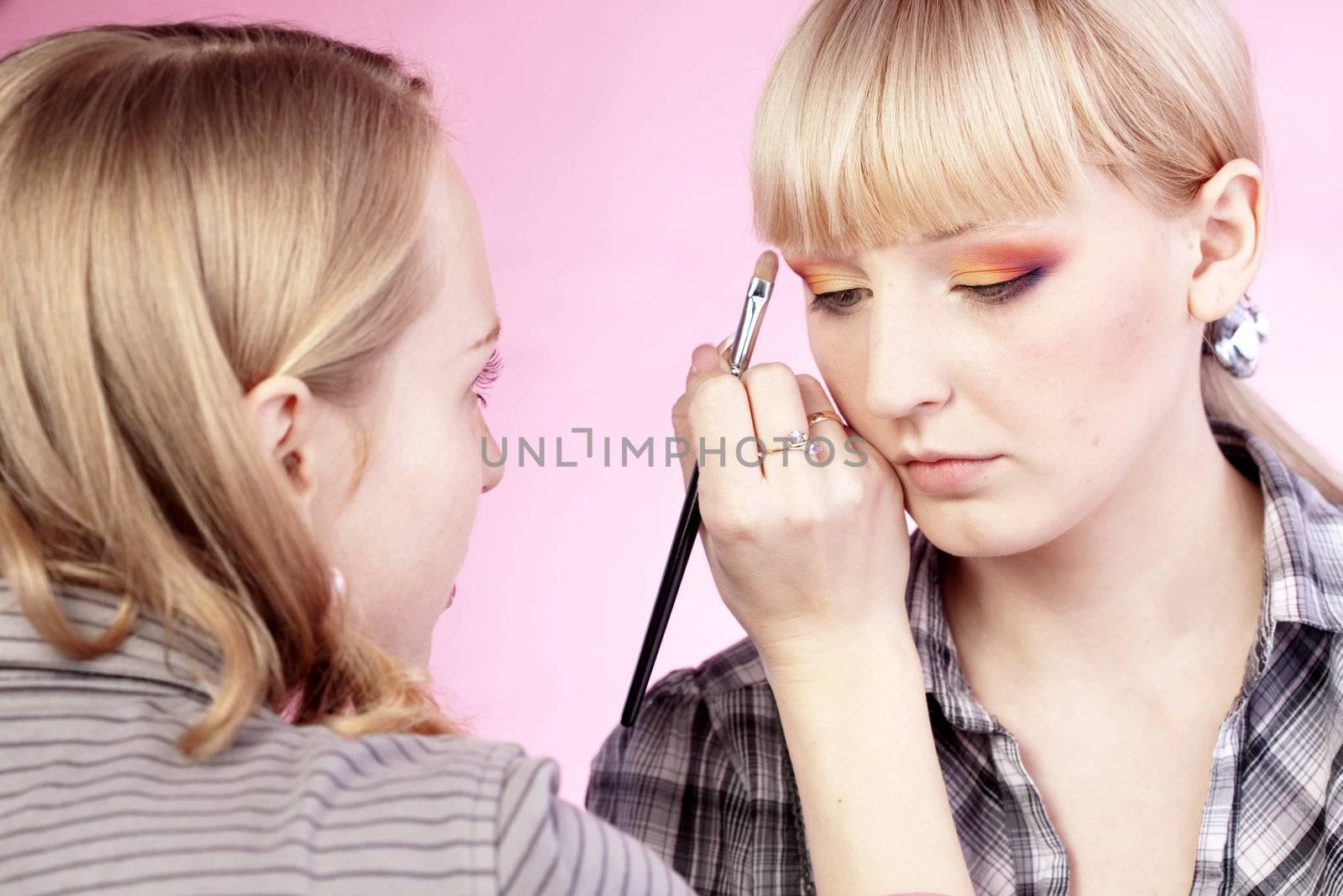 Studio series of doing fashion makeup