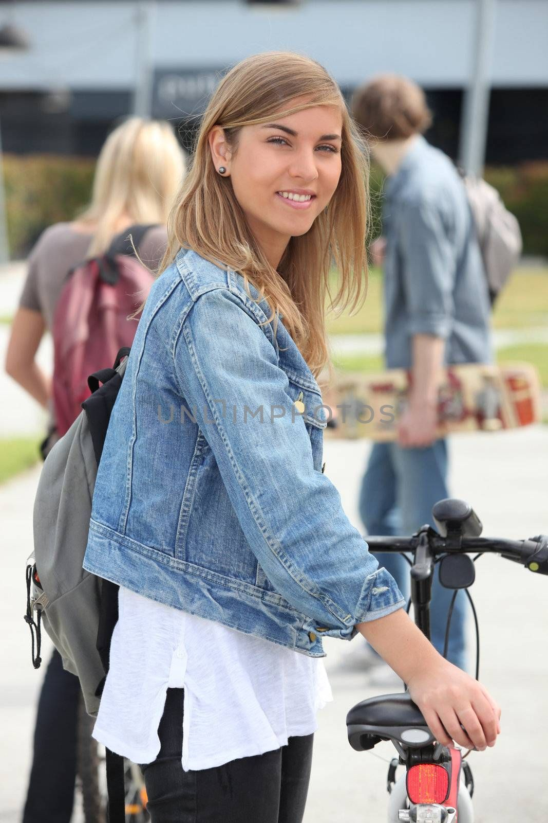 Smiling teenage girl with bicycle