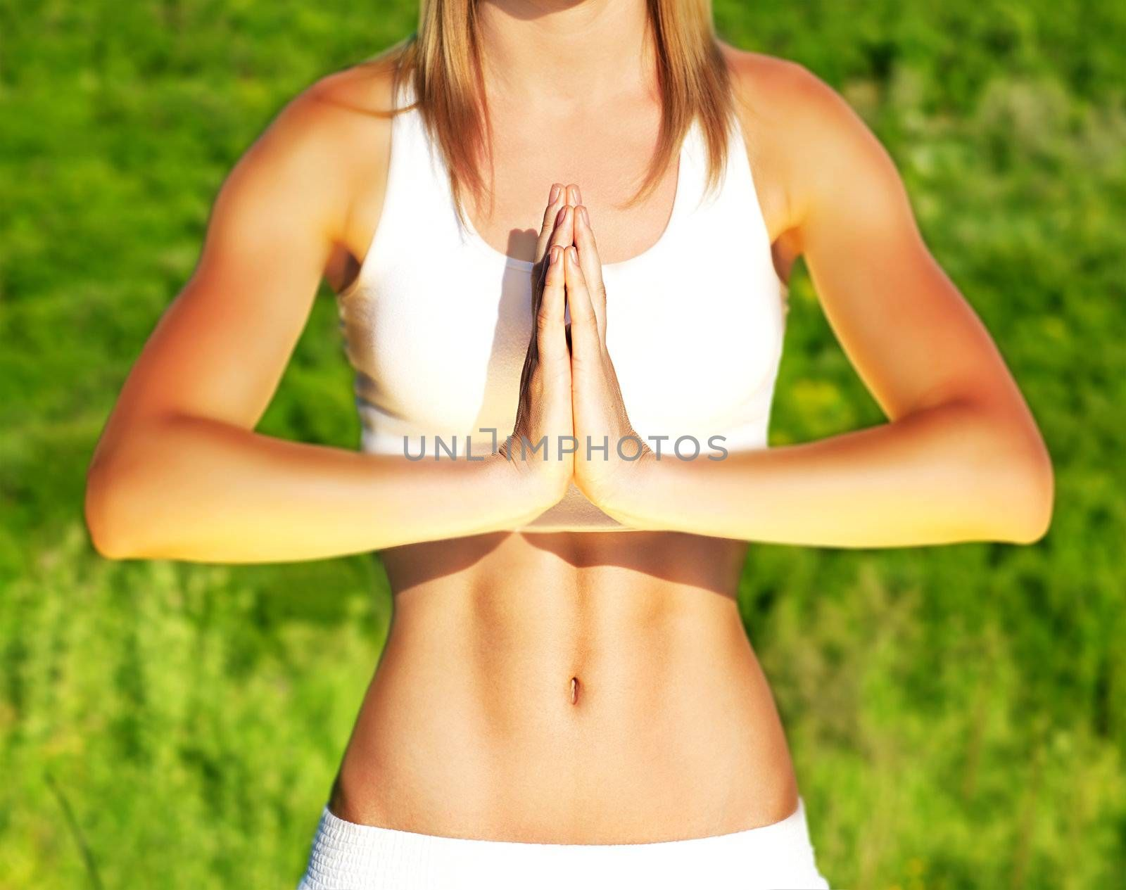Peaceful yoga outdoor, healthy sporty female body over green natural background, body care & fitness concept
