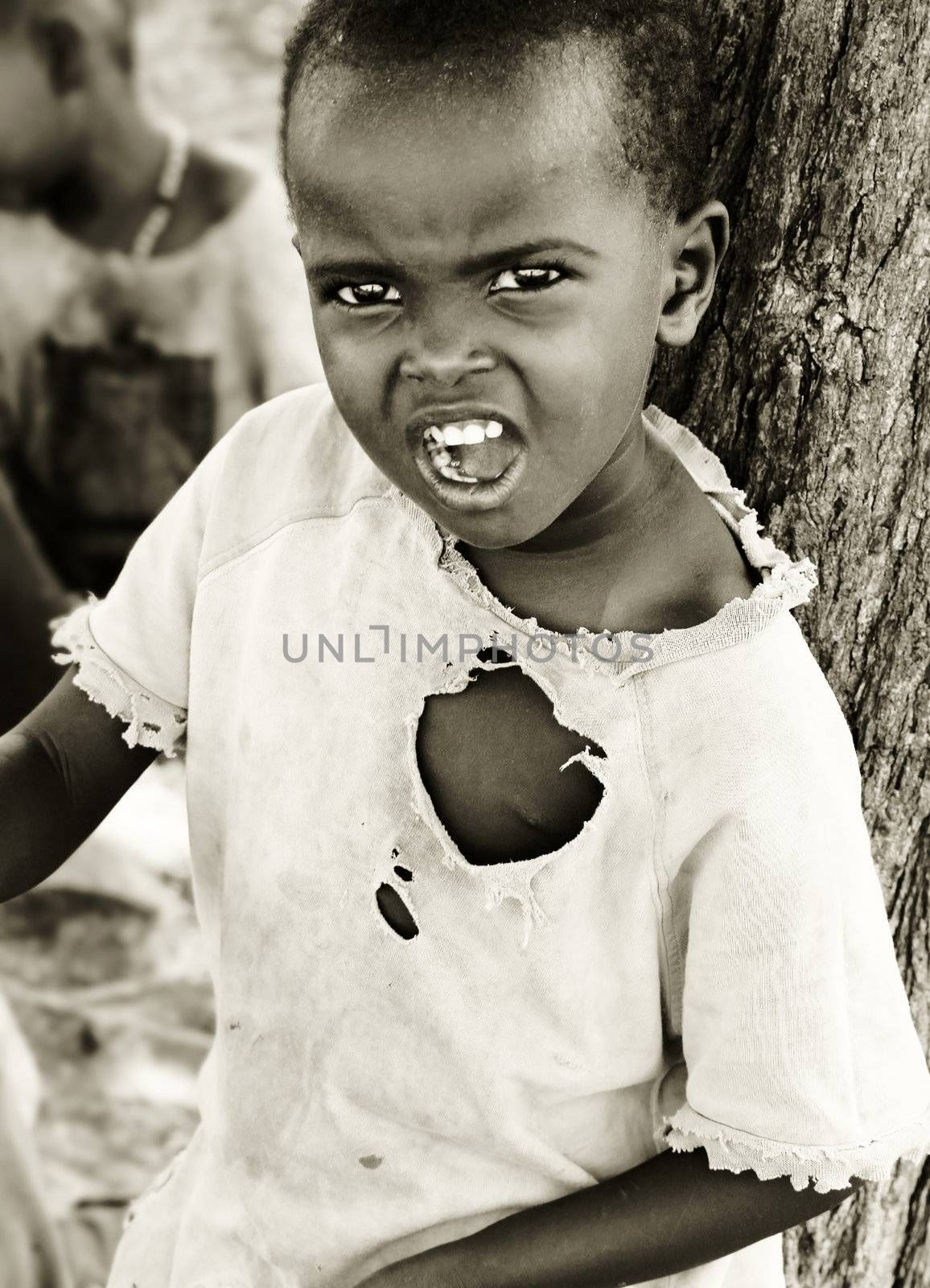 Portrait of African child expressing angryness. Editorial use only