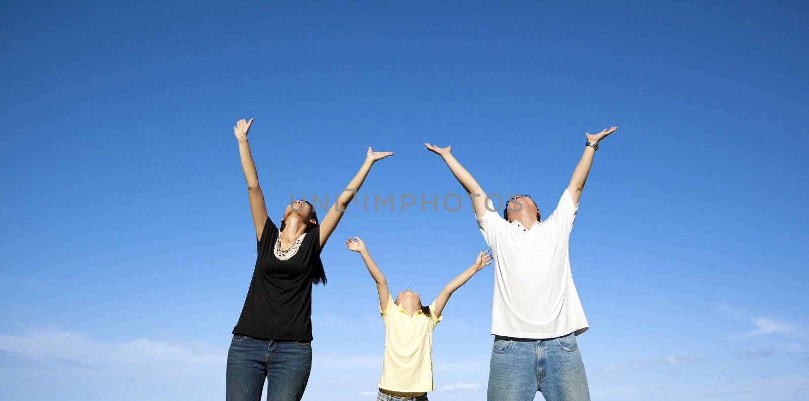 happy asian family with blue sky