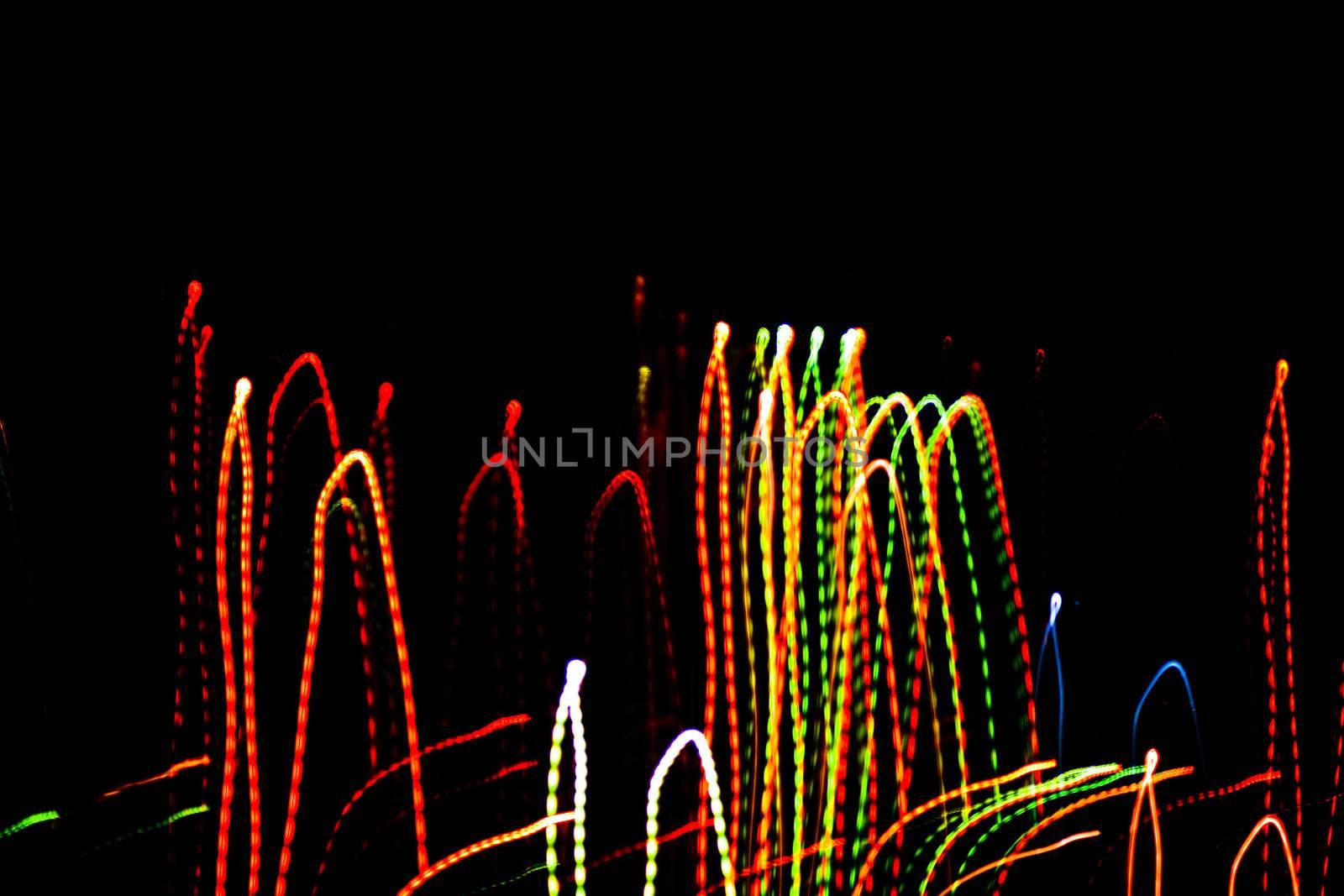 An image of abstract lights on black sky