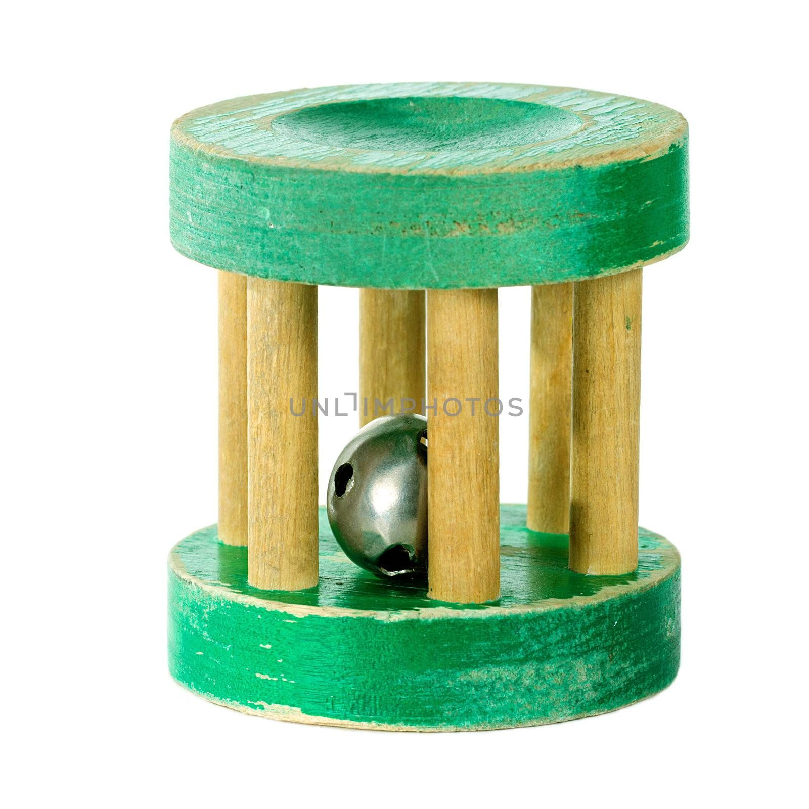 Antique wooden green rattle isolated on white