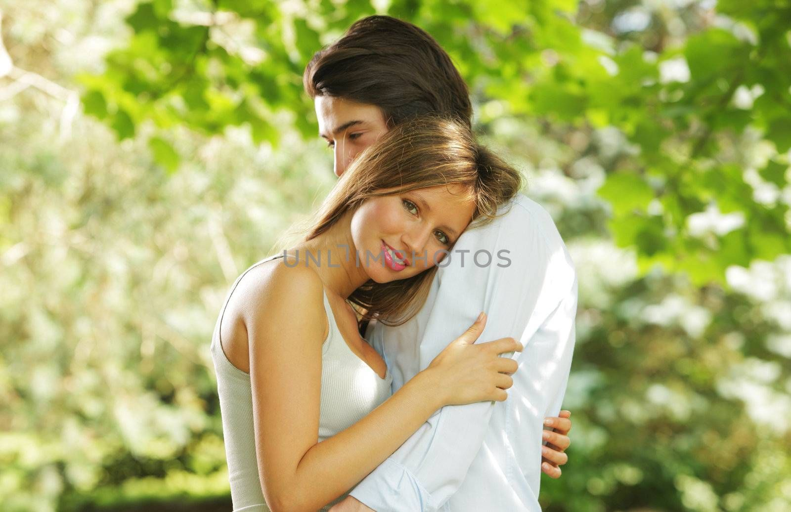the romantic embrace of a young couple in love