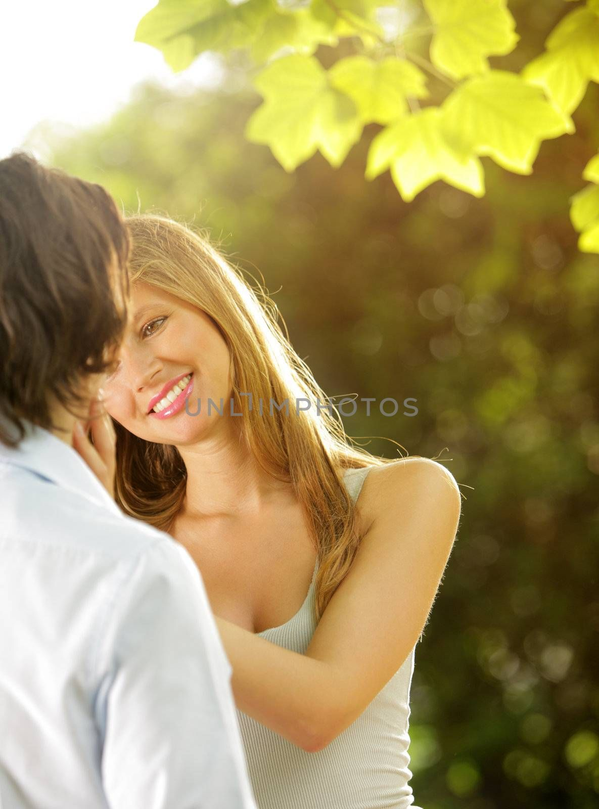 a young couple in love having fun in the park