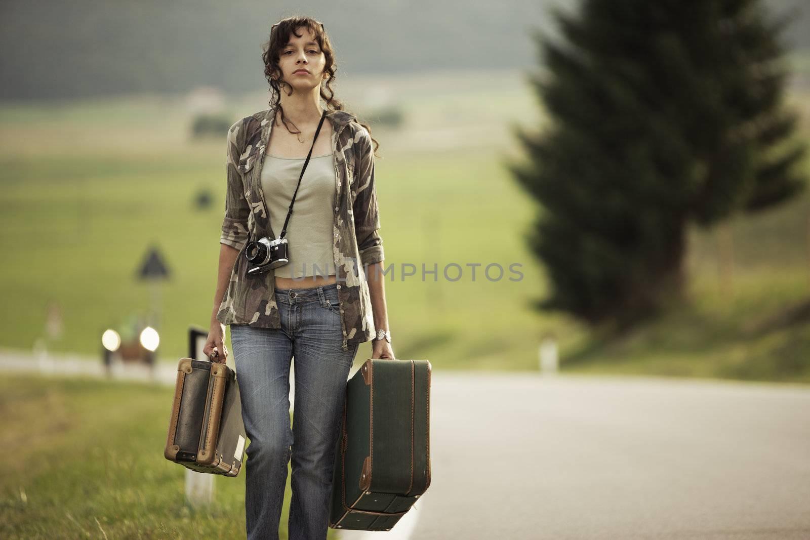 Young woman runaway walks away road