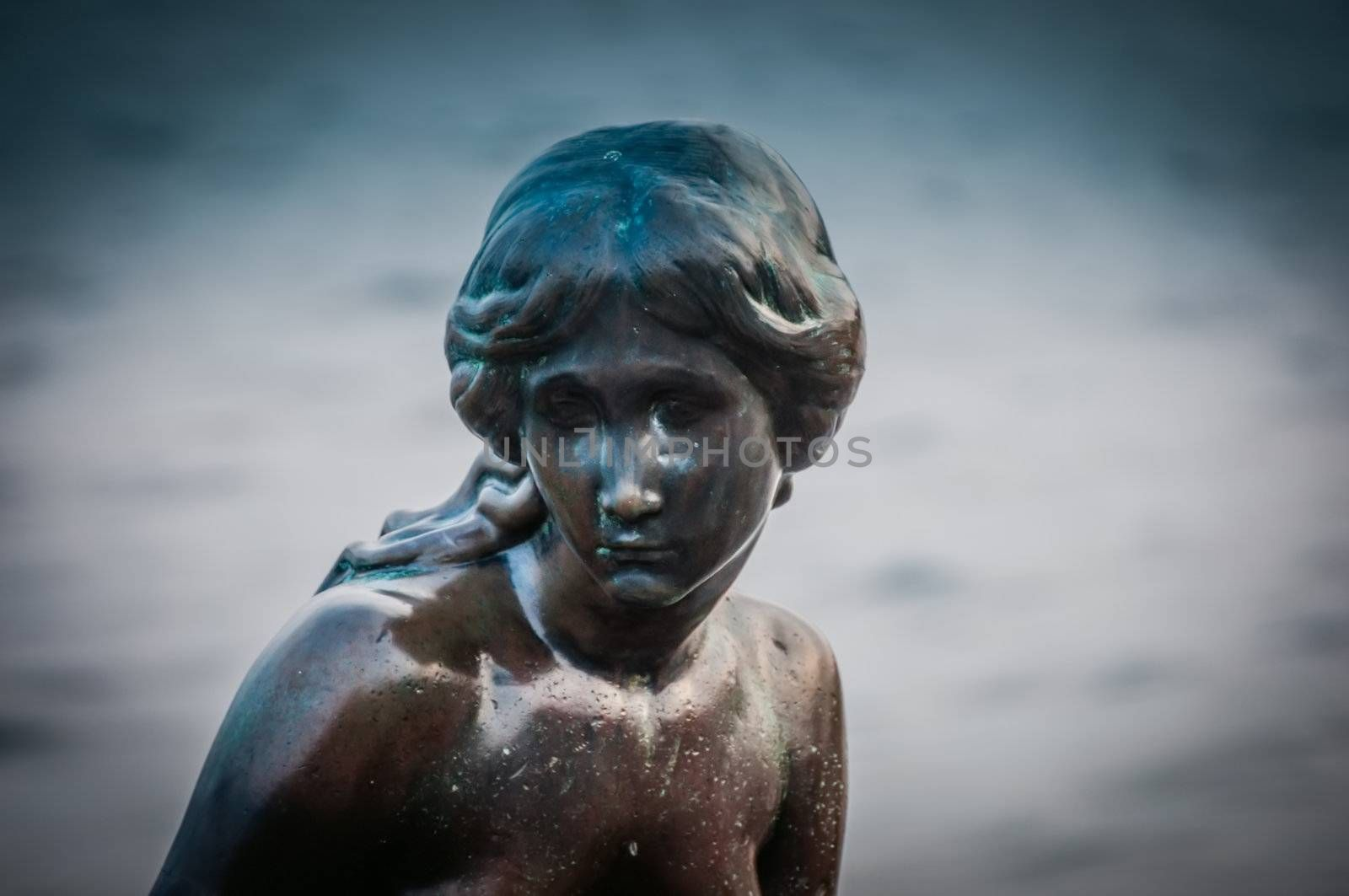 COPENHAGEN, DENMARK - JUNE 11: Mermaid statue in Copenhagen, Denmark, which is tourist attraction is build in 1913, based on the fairy tale of the same name by Hans Christian Andersen pictured on June 11, 2011