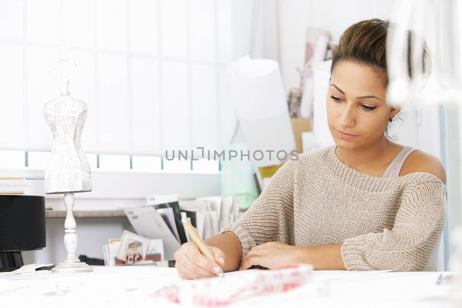 Fashion designer is drawing a fashion model