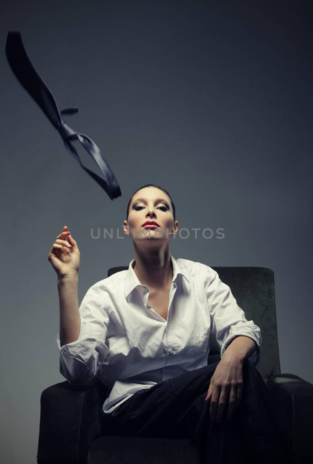Sensual woman throws the tie, fashion photo