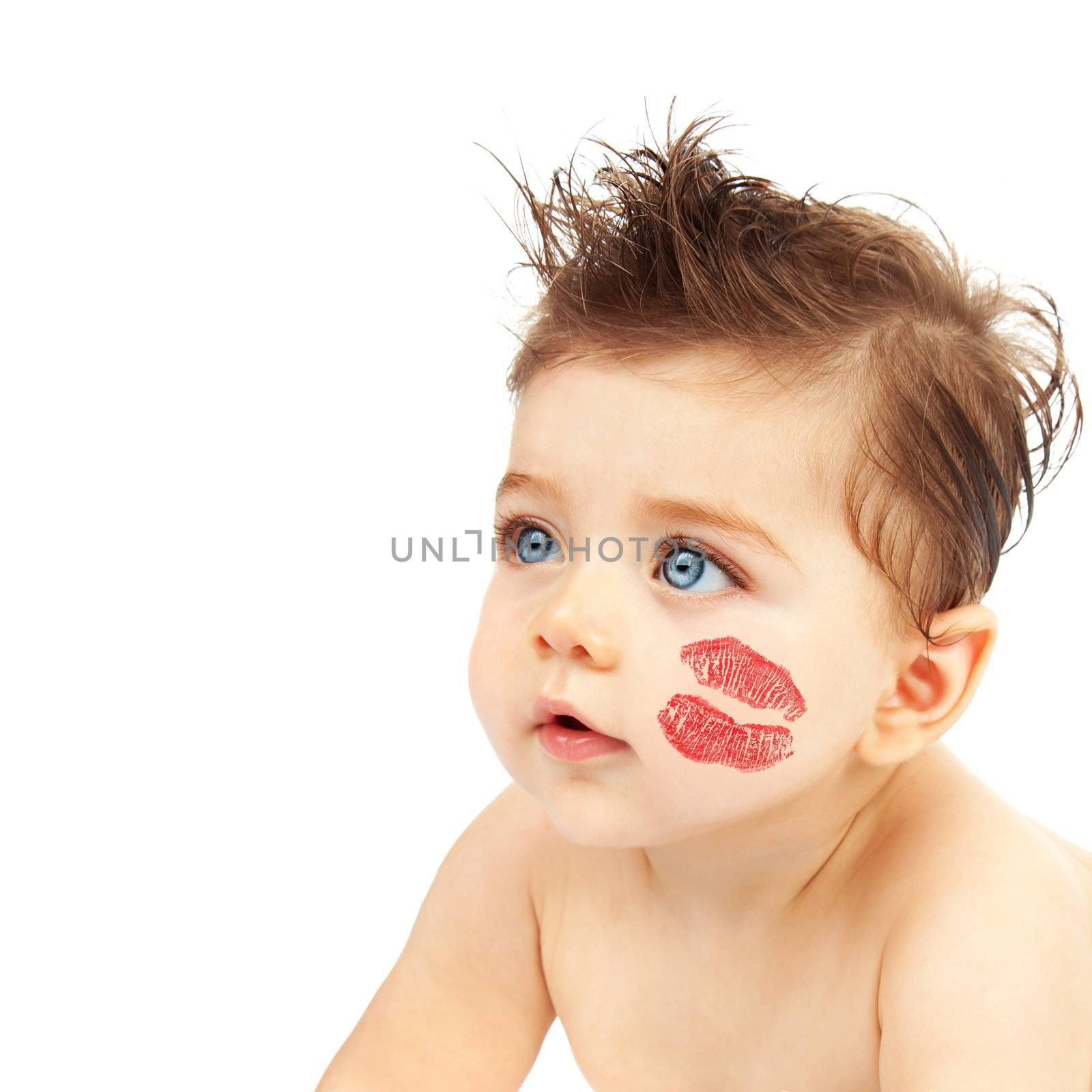 Photo of cute baby boy with red kiss on the cheek, closeup portrait of nice child with blue eyes isolated on white background, Valentine day, happy childhood, pretty Cupid, love concept