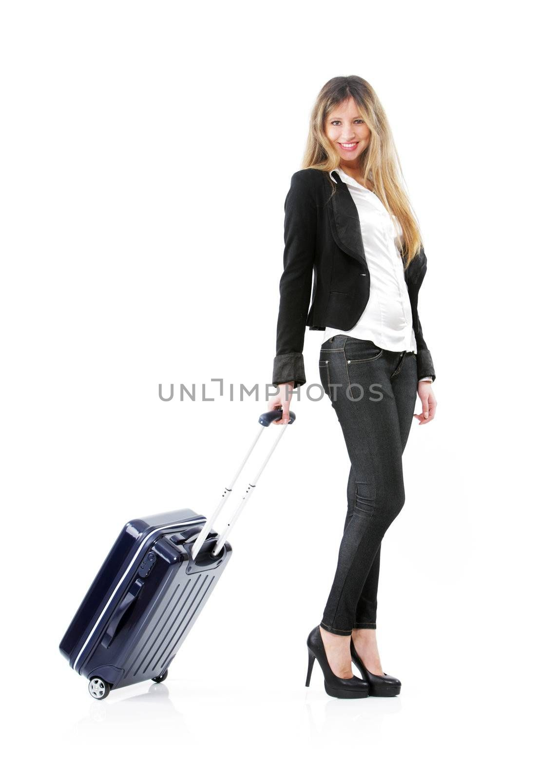 Beautiful young businesswoman with a rolling suitcase.