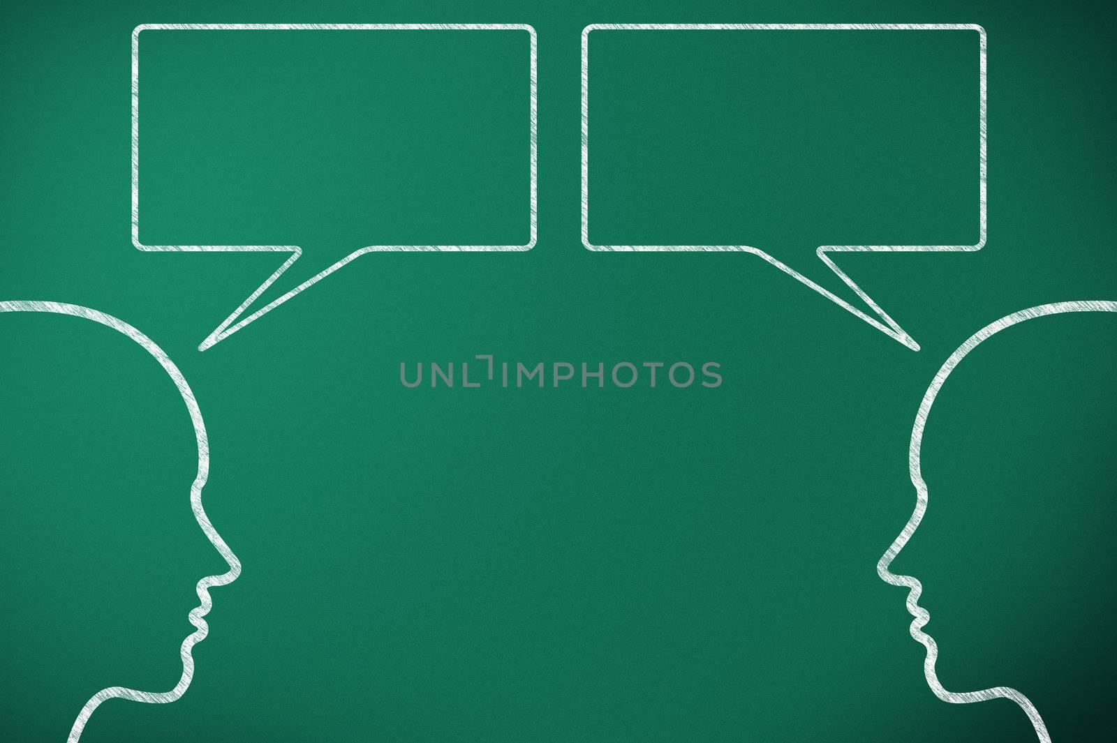 two head comunicate on green blackboard throught speech bubble