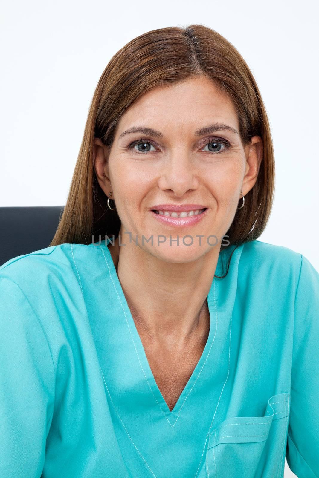 Closeup portrait of female dentist in scrubs smiling