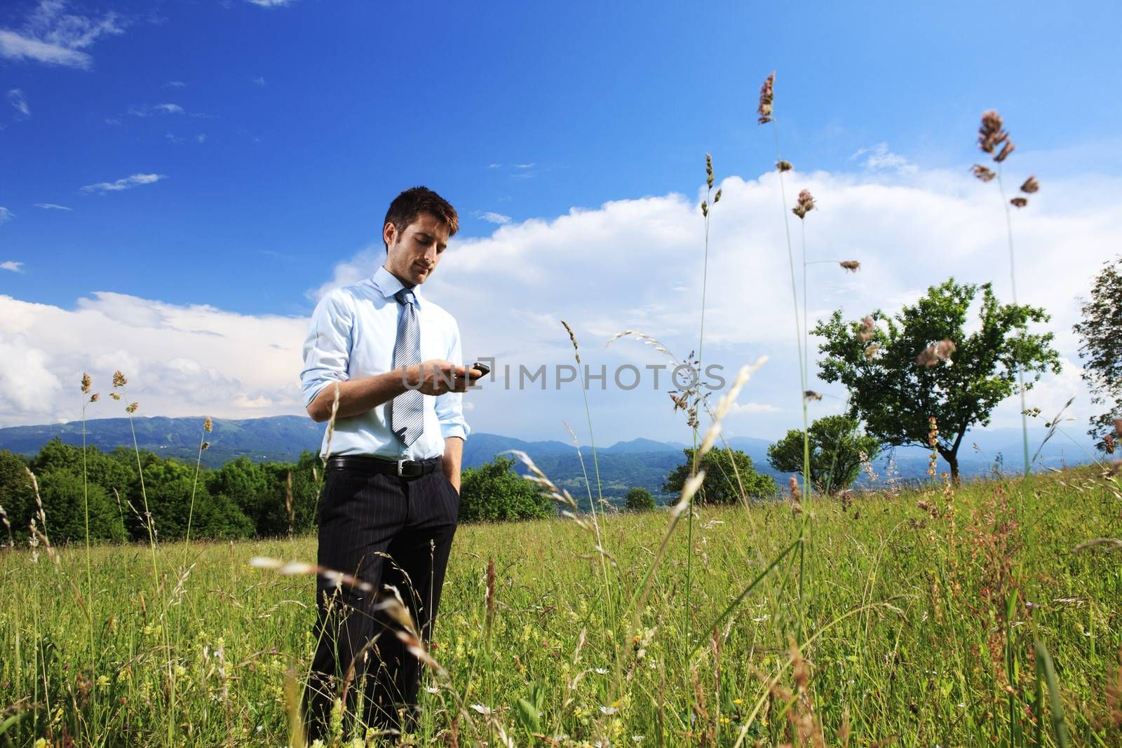 Young business man using a smart phone outdoors
