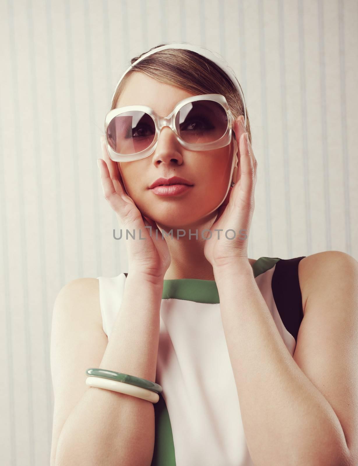 Portrait of fashion woman with retro sunglasses. 1960 style