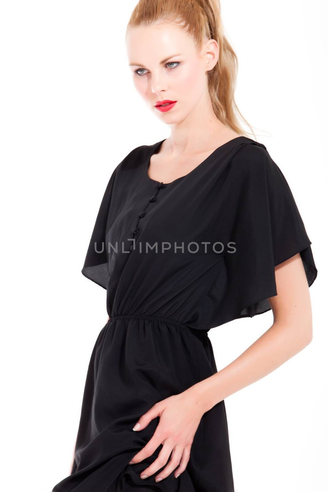 Beautifull young blond woman in the studio with a sexy black dress
