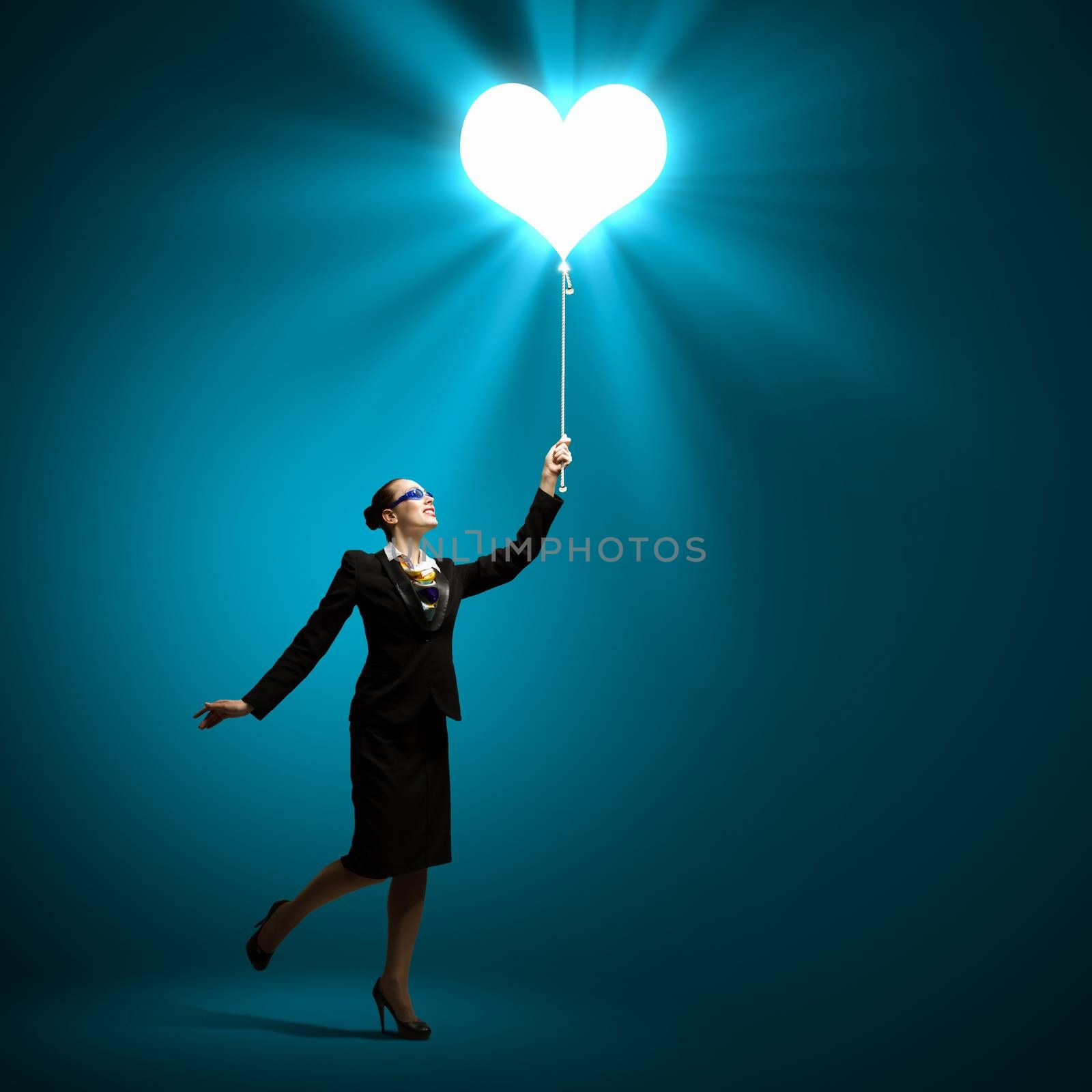 Image of businesswoman holding balloon with heart symbol