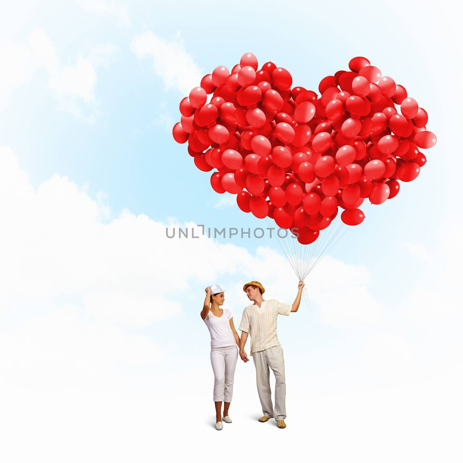 Image of young happy family with bunch of balloons