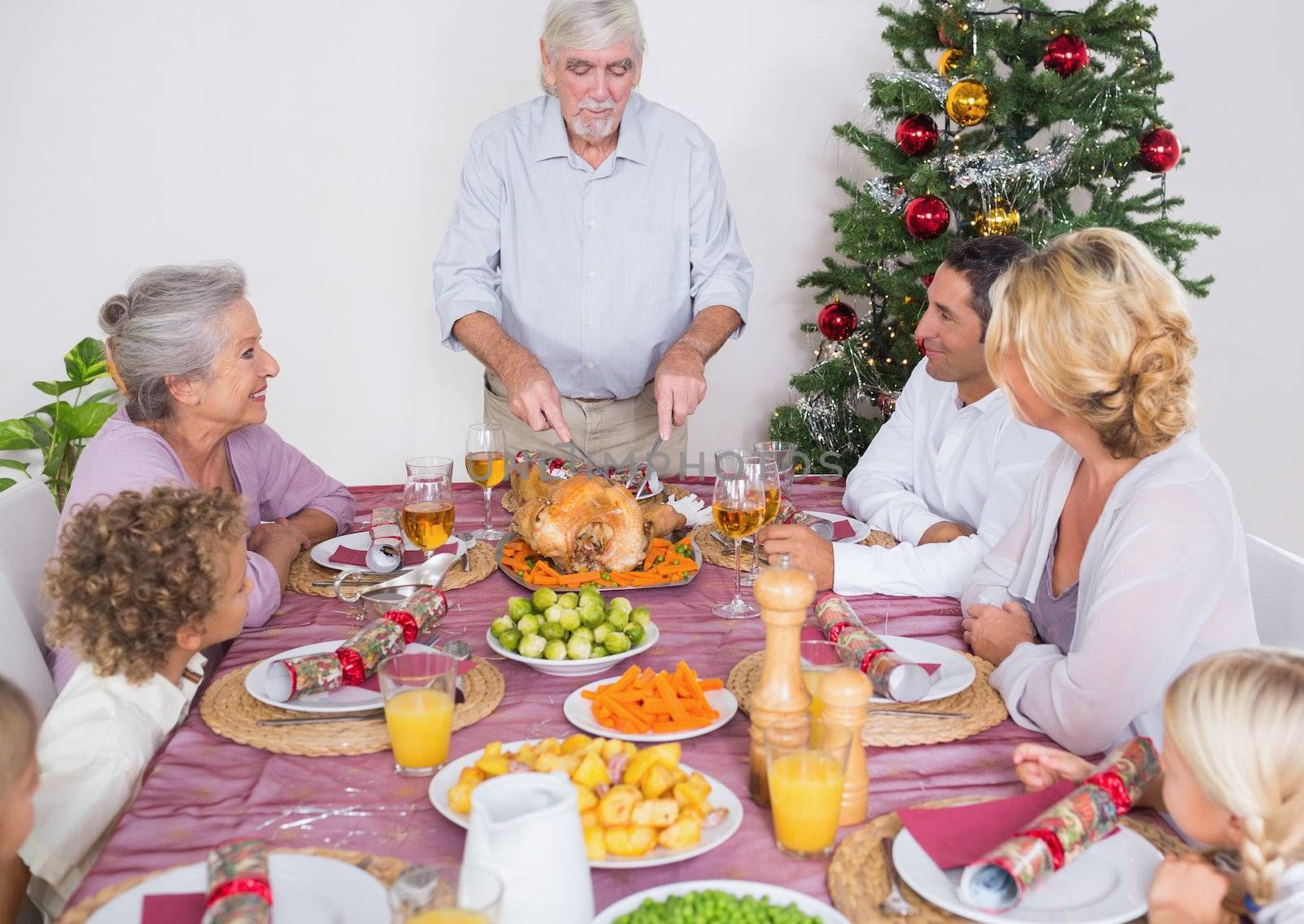 Grandfather carving the turkey for christmas dinner