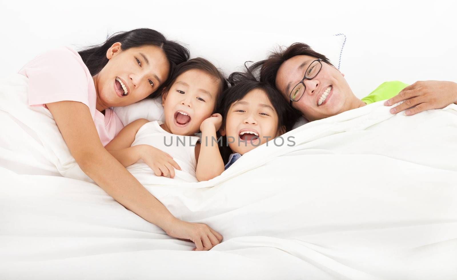 Happy   family on the bed